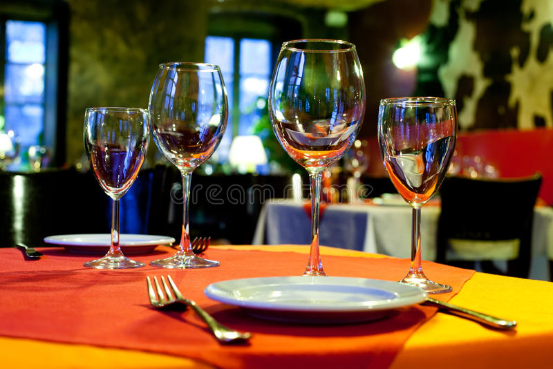 Served table with a bright tablecloth, napkins stock photo