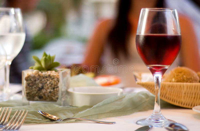 The served table with red wine at restaurant. (shallow dof stock photography