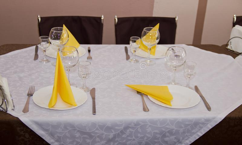 Served table in the restaurant. For four persons royalty free stock images