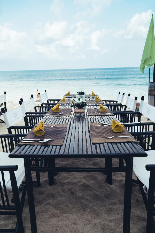 Served table at the sea shore on tropical beach royalty free stock image