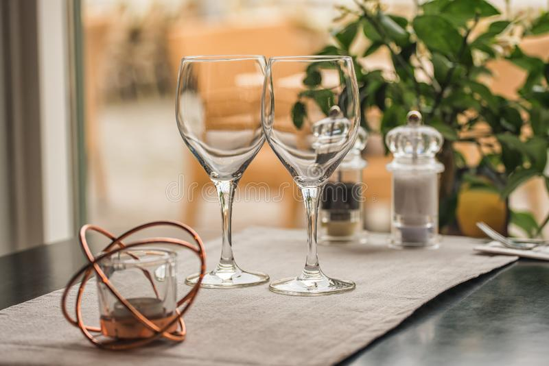 Served table set at summer terrace cafe with two glasses of wine royalty free stock photos