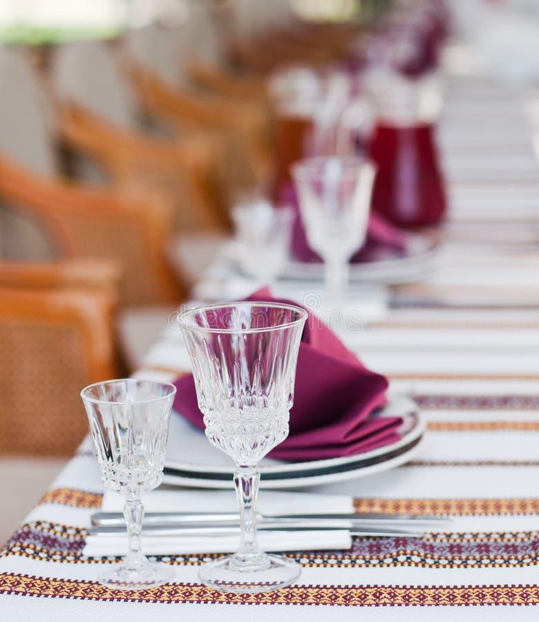 Served table in ukrainian restaurant. Served table with wineglasses in classic ukrainian restaurant stock image
