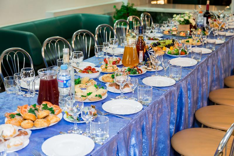 Served tables at the Banquet. Drink, alcohol, delicacies and snacks. Catering. A reception event.  stock photos
