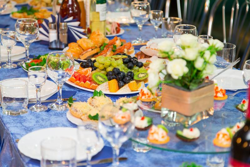 Served tables at the Banquet. Drink, alcohol, delicacies and snacks. Catering. A reception event.  stock image