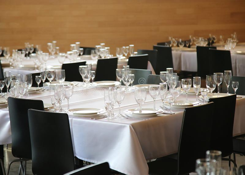 Served tables ready for guests stock photography