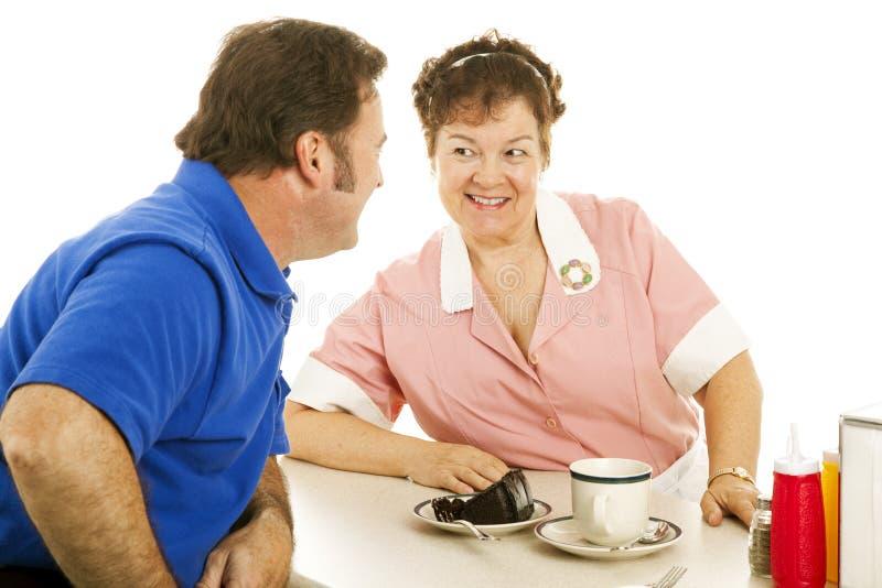 Serveerster die met Klant flirt stock afbeeldingen