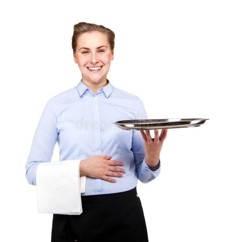 Serveerstervrouw glimlachen geïsoleerd over witte achtergrond Holding t stock afbeelding