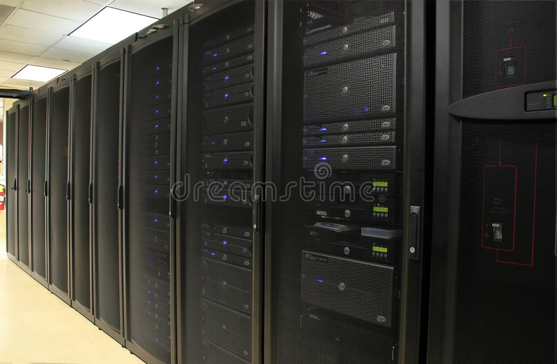 Server Farm: Data Center. Several racks of 1u and 2u servers in black cabinets in a computer operations room