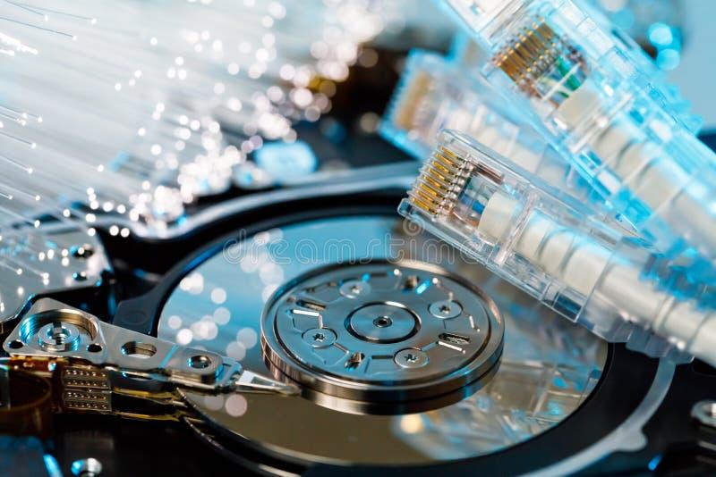 Server hard disks, illuminated optical fiber with blurred lights royalty free stock photos