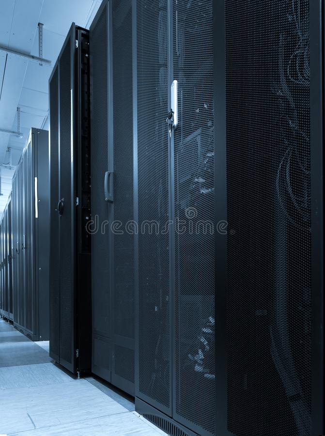 Server internet datacenter room interior with network panels, switches and cable in racks of hardware equipment. Network royalty free stock photos