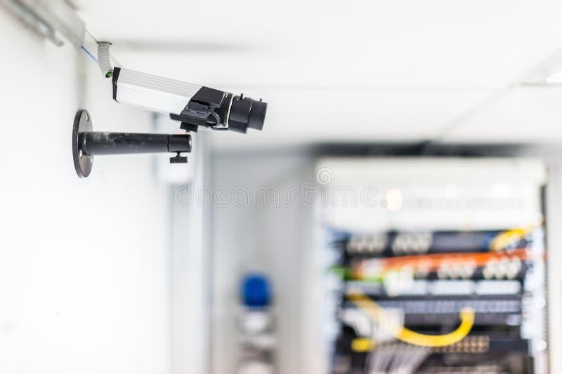 Server room cctv. A cctv security surveillance camera in a server room stock photo