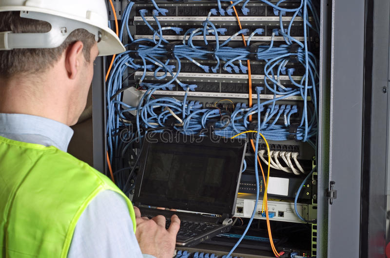 Server and wires during check-up stock image