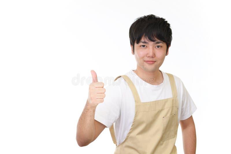 Serveur asiatique de sourire images stock