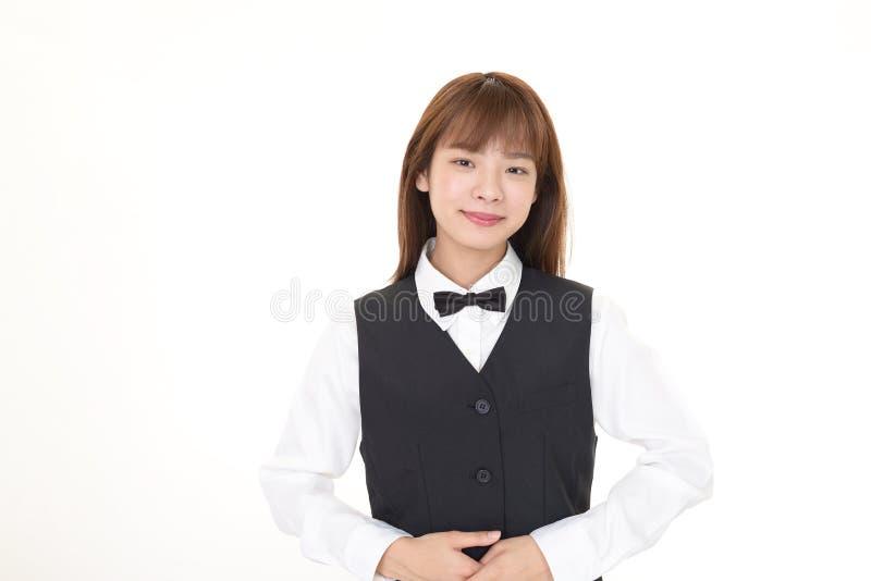 Serveuse asiatique de sourire image stock