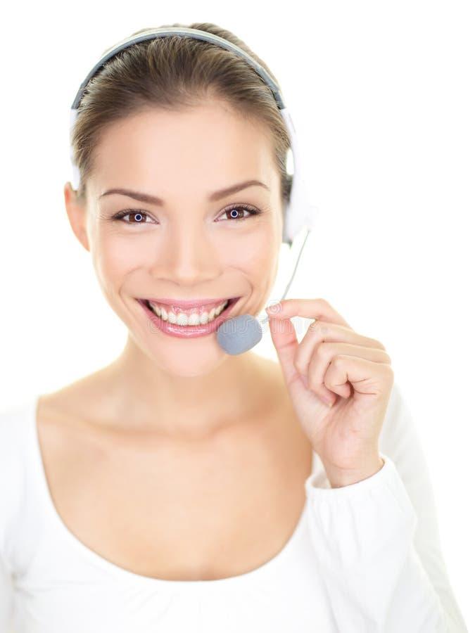 Serviço ao cliente de sorriso do centro de atendimento da mulher dos auriculares imagens de stock royalty free
