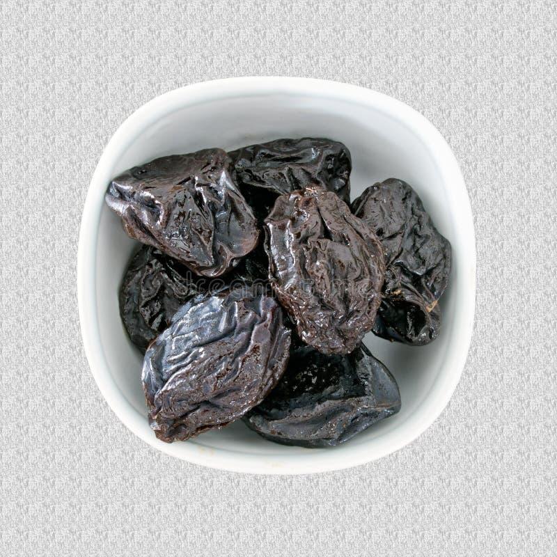 Serviço de ameixas secas secadas, ameixas, laxante natural fotografia de stock royalty free