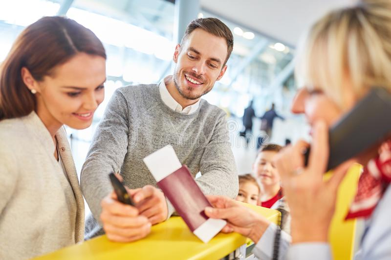 Service Agent checks passport at check in counter stock photo
