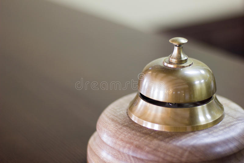 Service bell in a hotel reception for concierge alarm on desk. Service bell in a hotel reception for concierge alarm on desk stock photos