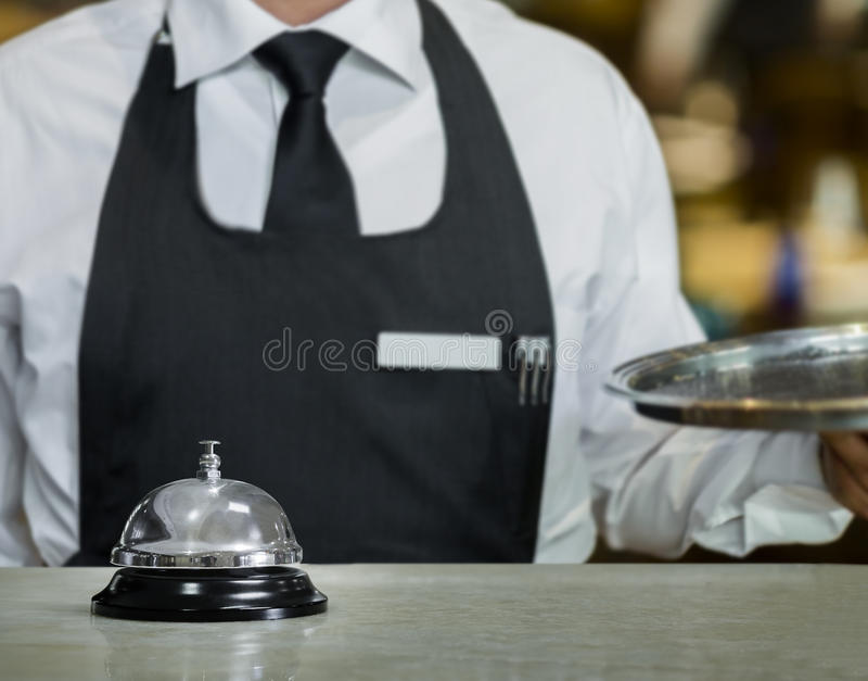 Service bell and the Waiter royalty free stock photo