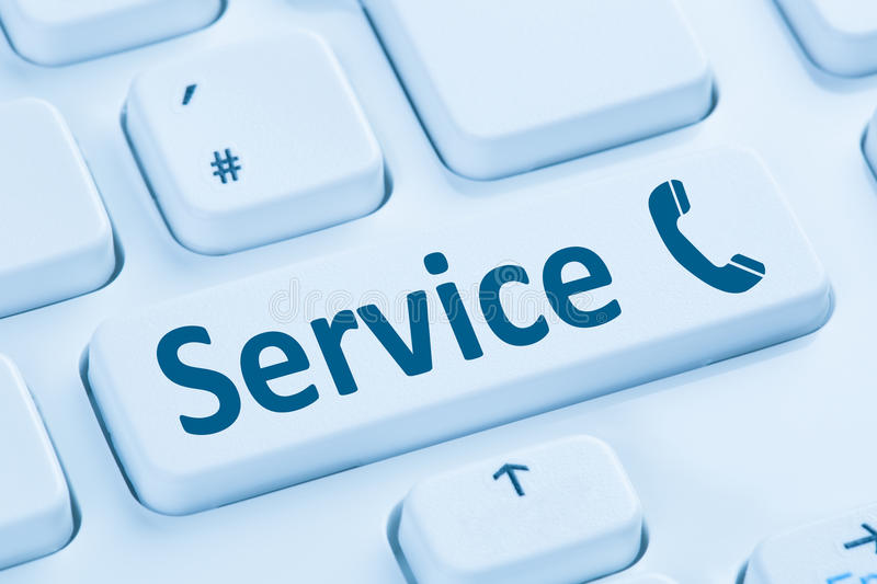 Service customer hotline telephone call calling blue computer keyboard royalty free stock image