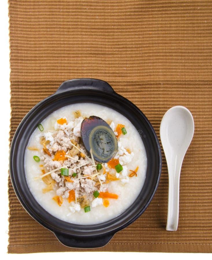 Service de gruau de riz de gruau d'oeufs et de porc de siècle images stock