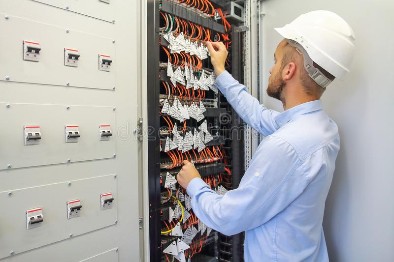 Service Engineer adjusts equipment in data center. Server room of datacenter royalty free stock photos