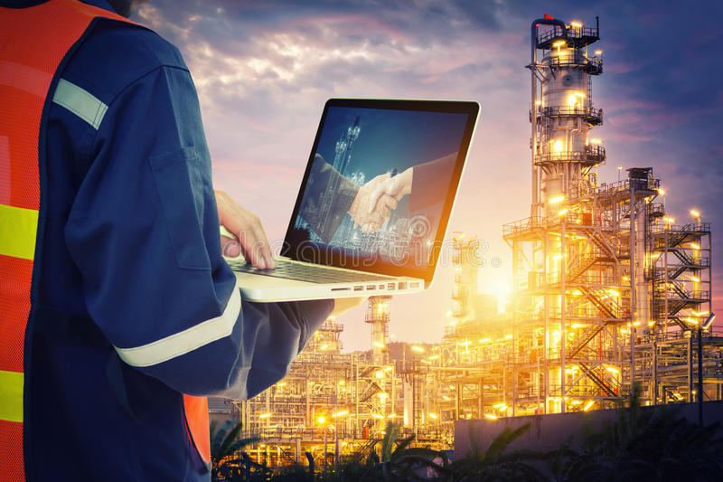 Service engineer working with laptop. In Oil Refinery stock image