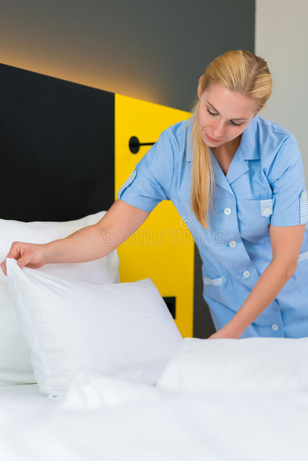 Download Service In Hotel, Maid Puts Clean Sheets On Bed Stock Image - Image: 33421127