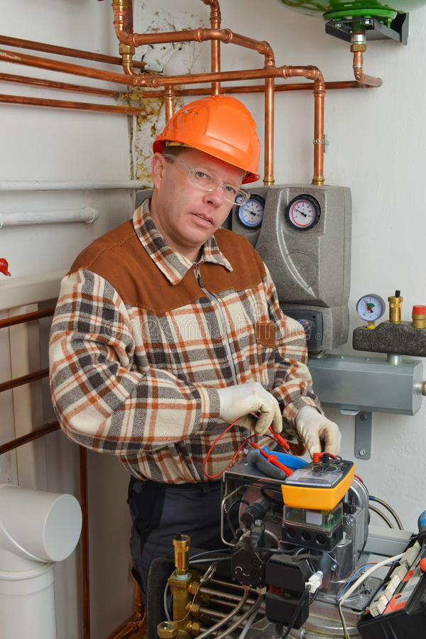 Service Man Working on Furnace royalty free stock image