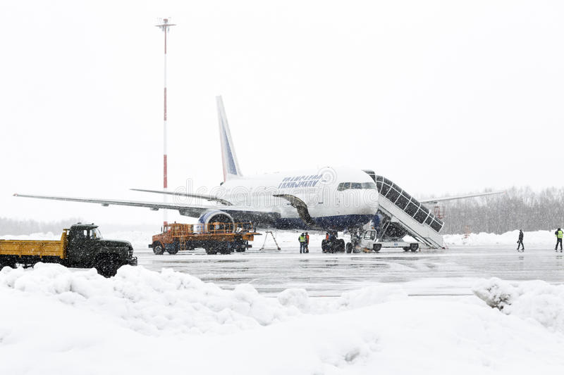 Service and technical support airfield maintenance Boeing-767 at airport of Petropavlovsk-Kamchatsky. PETROPAVLOVSK-KAMCHATSKY, KAMCHATKA, RUSSIA - MARCH 19 royalty free stock photo