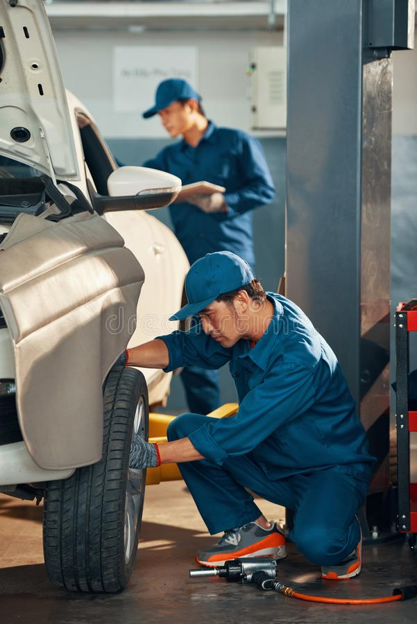 Car maintenance in garage royalty free stock photography