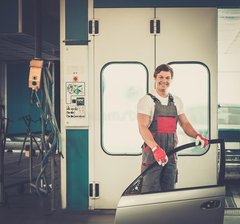 Serviceman in a car workshop stock images