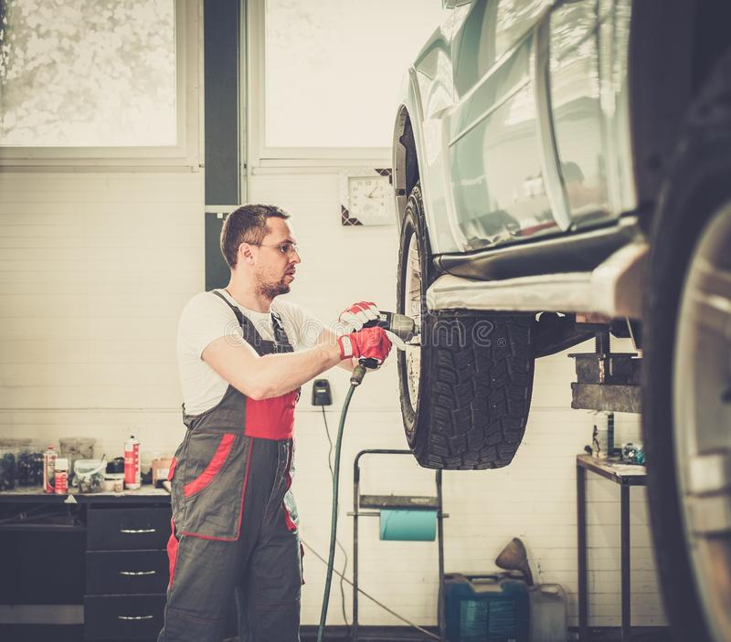 Serviceman in car workshop royalty free stock photos