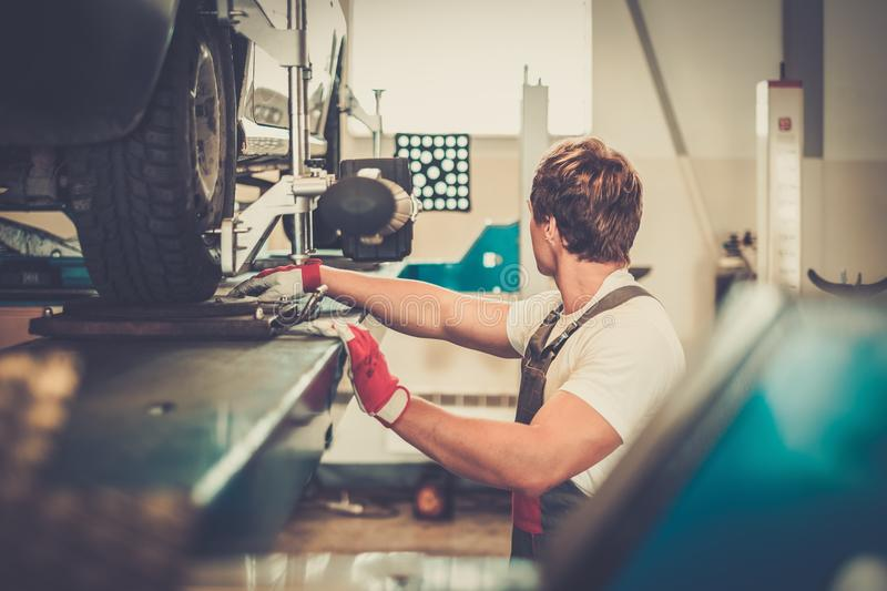 Serviceman in a car workshop royalty free stock photography