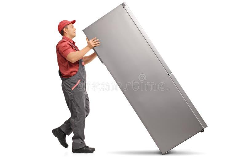Serviceman with a fridge stock image