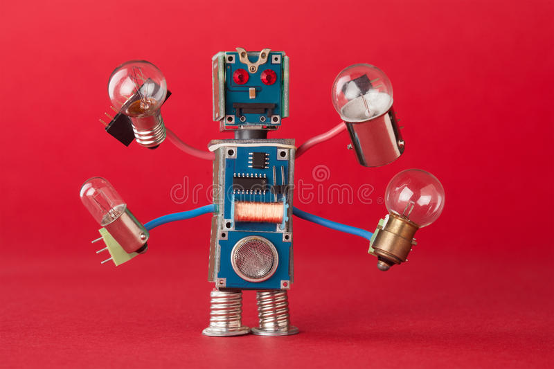 Serviceman illuminator with light bulbs in four hands. Colorful robotic character holds different retro lamps. Funny stock photos