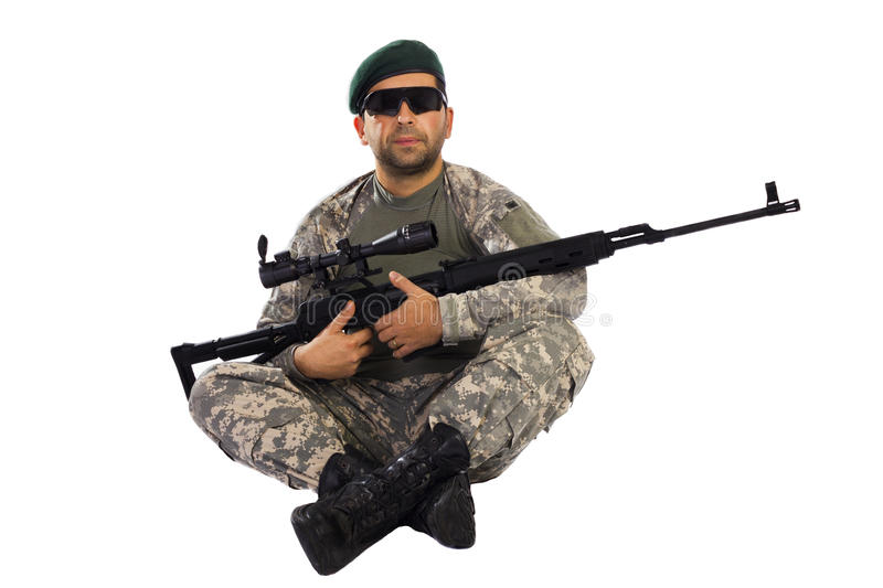 Serviceman sitting down with a sniper riffle stock photo