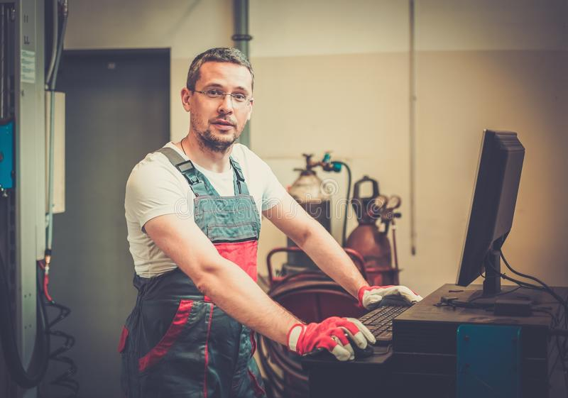 Serviceman in a workshop stock photography