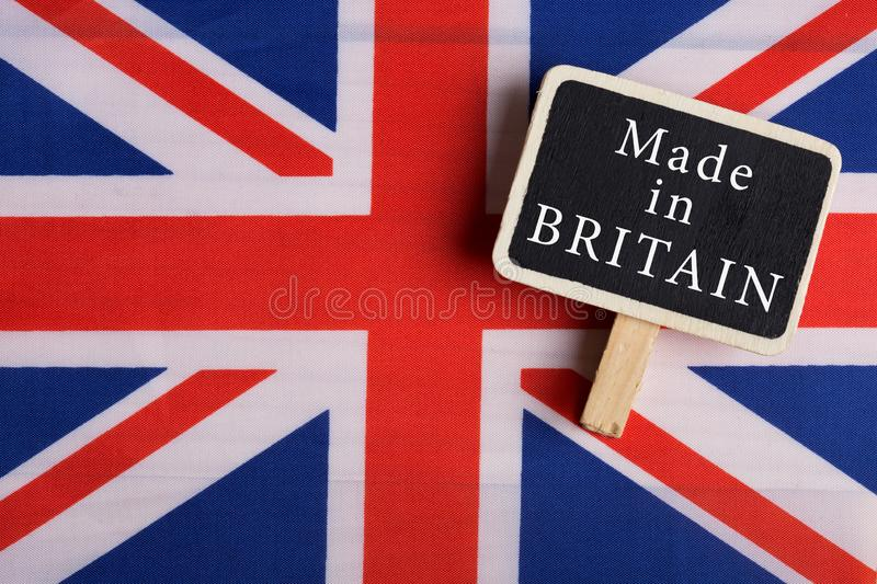 services concept - Great Britain country's flag, blackboard with text Made in Britain stock images