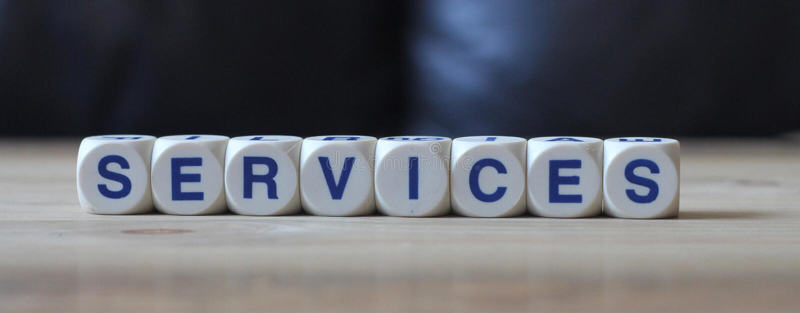 Services. Letters cube wordings on wood background stock photo