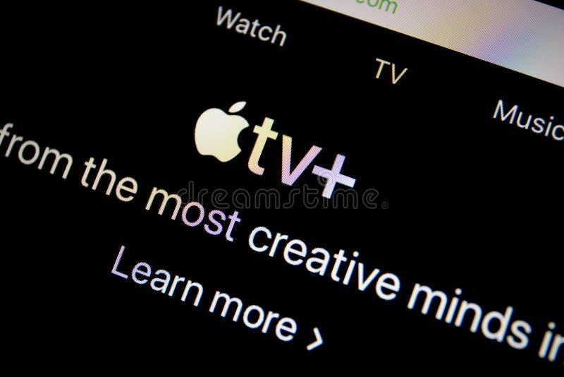 Servicio Apple TV del sitio web del icono más la pantalla Macbook imagen de archivo