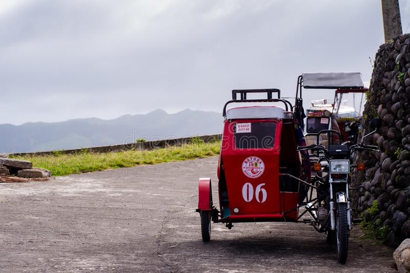 Servicio del transporte del triciclo en Batanes, Filipinas imágenes de archivo libres de regalías