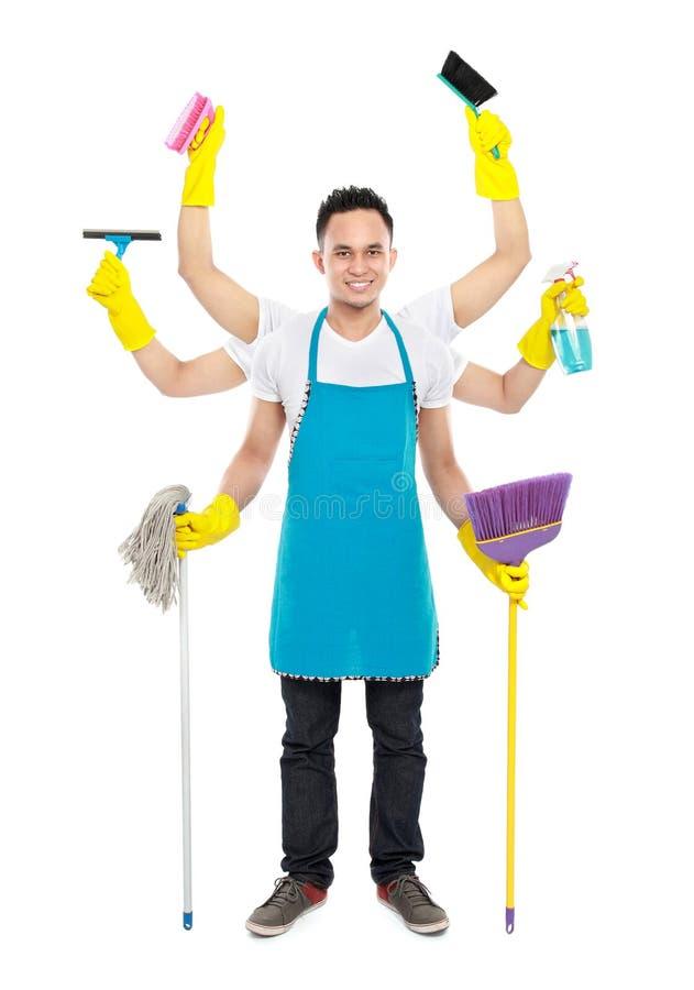 Servicio masculino ocupado de la limpieza foto de archivo libre de regalías