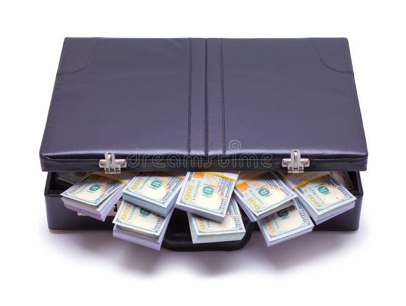 Serviette bourrée de l'argent photographie stock