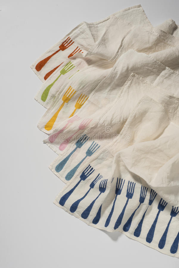Serviette-Ecken mit bunten speisenden Gabel-Mustern in Laye stockfoto