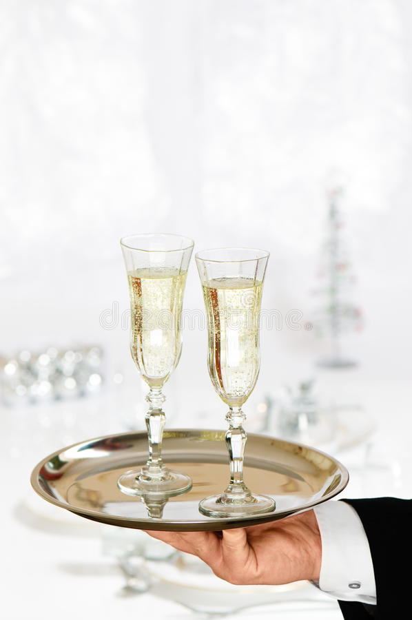 Serving Christmas Champagne royalty free stock image