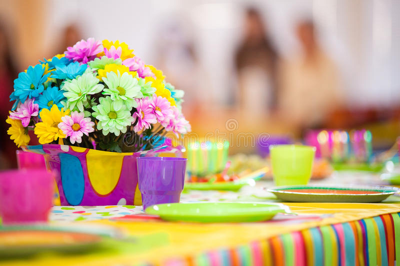 Serving colorful table with decoration for child birthday stock image