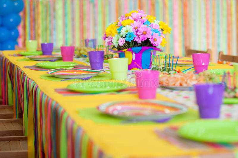 Serving colorful table with decoration for child birthday royalty free stock photos