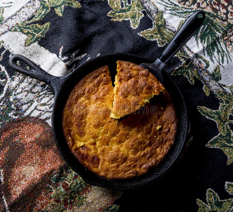 Serving Corn Bread in Cast-Iron Pan royalty free stock image