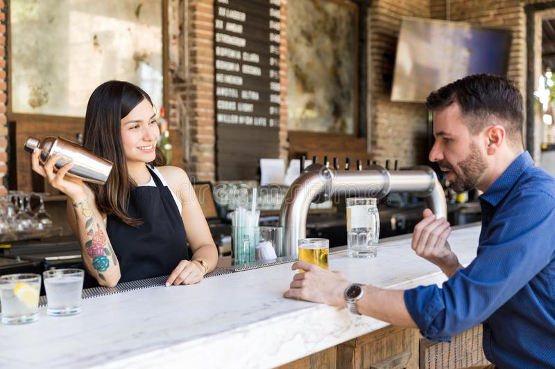 Serving Customer With Smiling Face Is My Moto stock photography